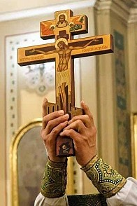 Before your Cross, we bow down in worship O, Master
